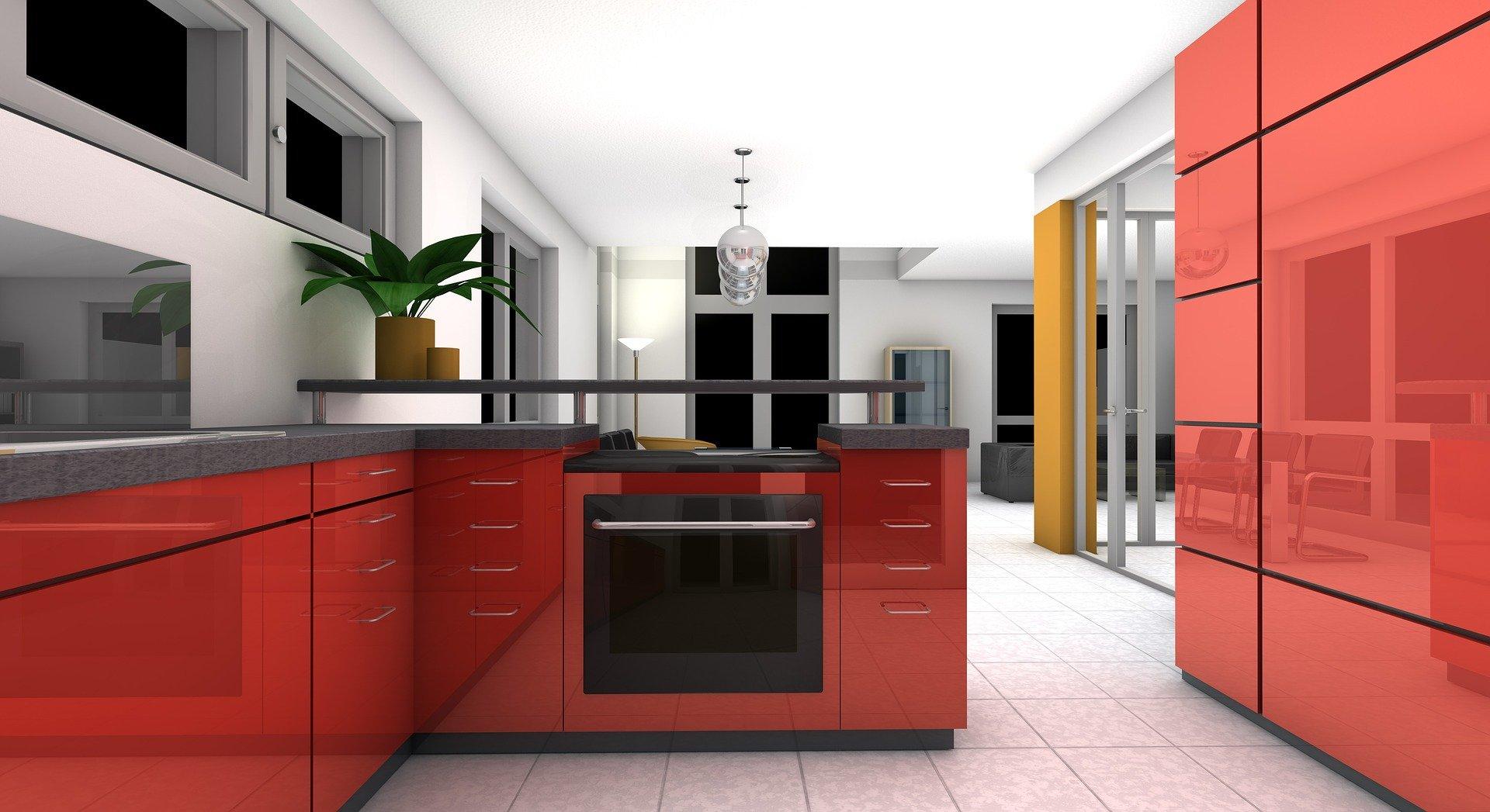Mieszkanie zakupione z gdańskiego skupu mieszkań. Na zdjęciu widać kanapę, szafę, obraz oraz roślinę w doniczce.